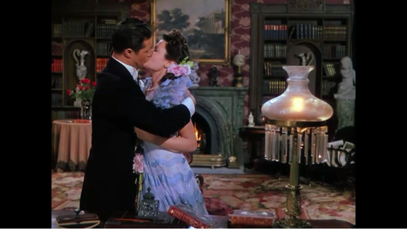 Don Ameche kissing Gene Tierney