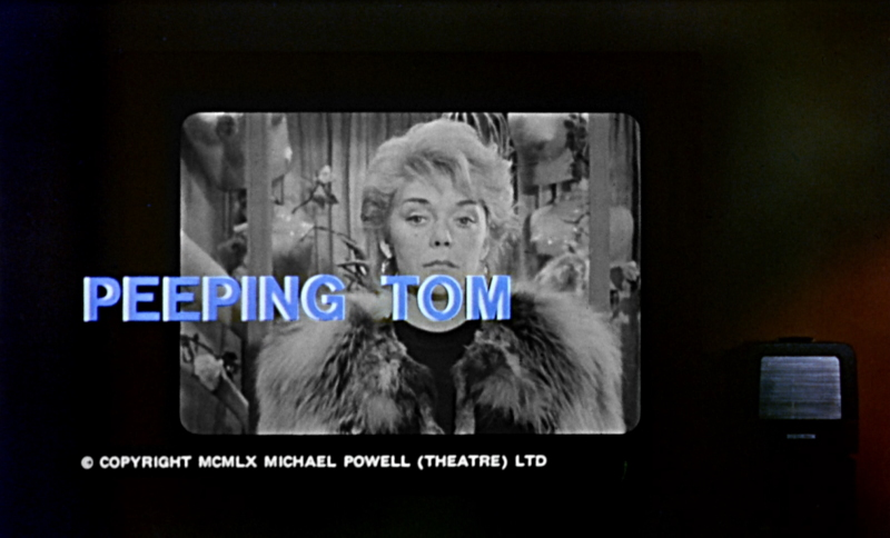 title screen of peeping tom blond woman